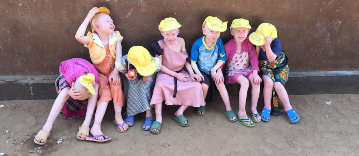 Buh kids in yellow hats